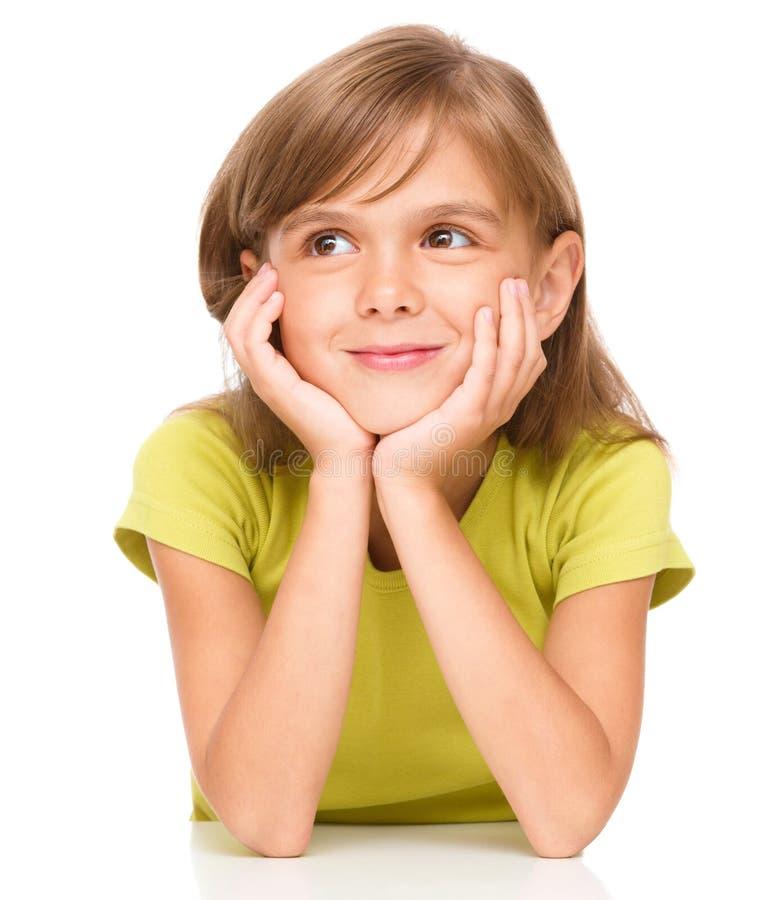 Portrait d'une petite fille songeuse photo libre de droits