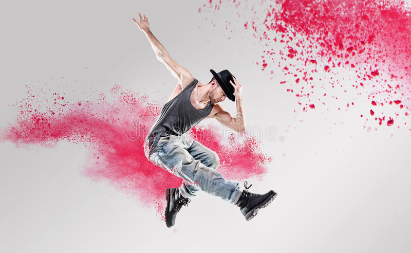 Portrait of a dancer excercising among a colorful dust stock photography