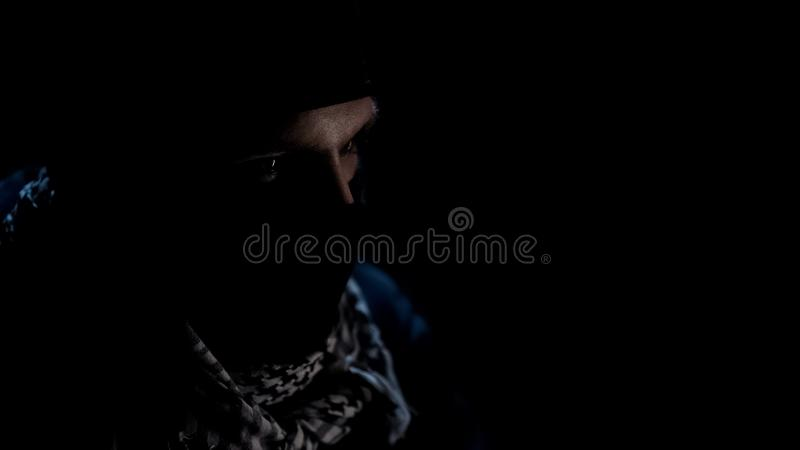 Portrait of dangerous islamist in mask, terrorism as global threat, template. Stock photo stock image