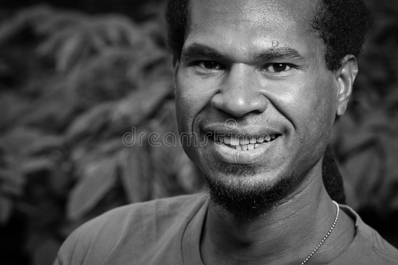 Portrait of a dark skinned young man royalty free stock photography
