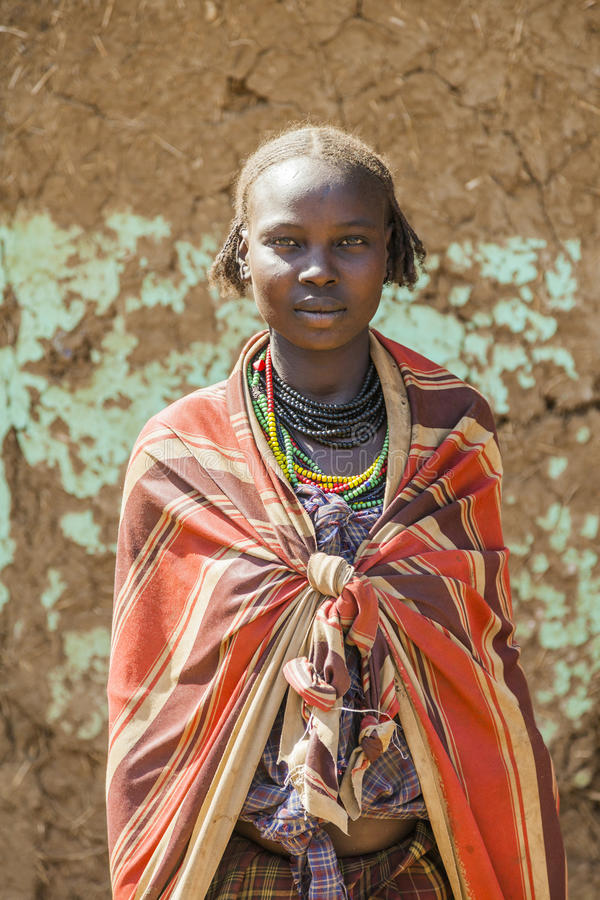 Portrait of Dassanech girl. Omorato, Ethiopia. OMORATO, LOWER OMO VALLEY, ETHIOPIA - JANUARY 31, 2012: Portrait of unidentified Dassanech girl. Omorato one of royalty free stock photo