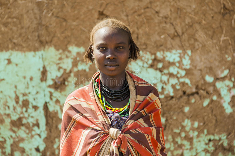 Portrait of Dassanech girl. Omorato, Ethiopia. OMORATO, LOWER OMO VALLEY, ETHIOPIA - JANUARY 31, 2012: Portrait of unidentified Dassanech girl. Omorato one of royalty free stock photos