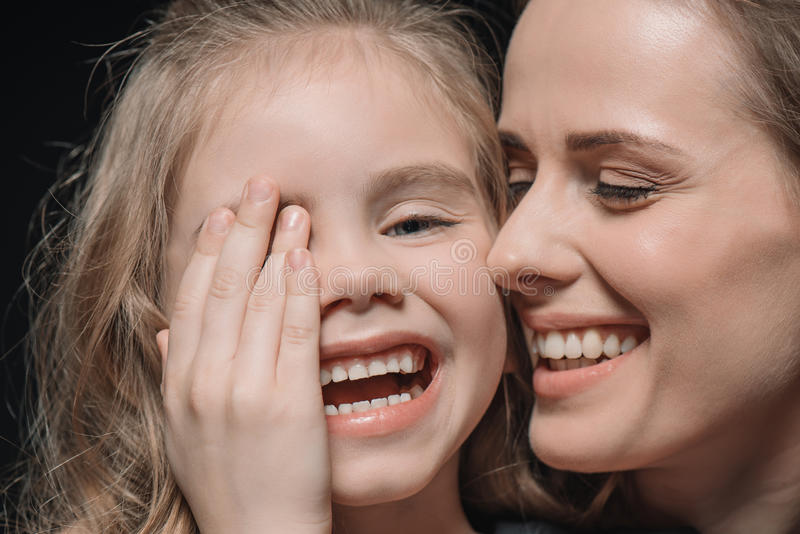 Portrait of daughter and mother laughing stock photography