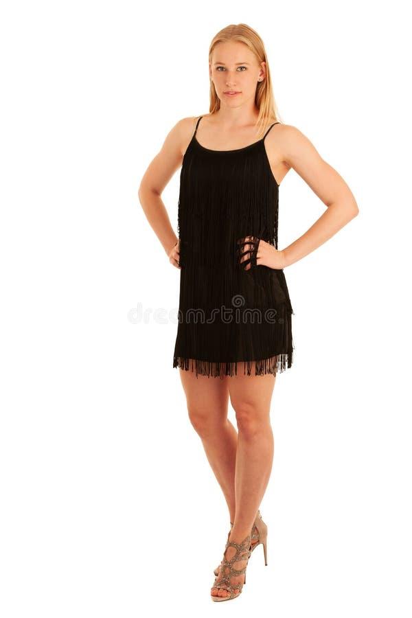 Portrait de beauté d'une femme blonde mignonne dans les dres noirs courts d'été photographie stock