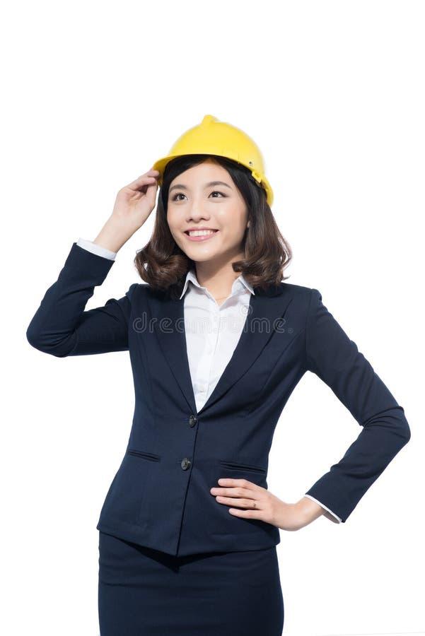 Portrait de casque de port de jeune d'architecte femme d'étudiant photos stock