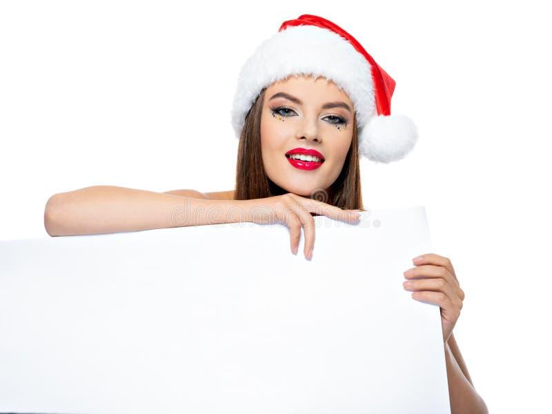 Portrait de femme dans un chapeau de Santa avec la bannière photo libre de droits