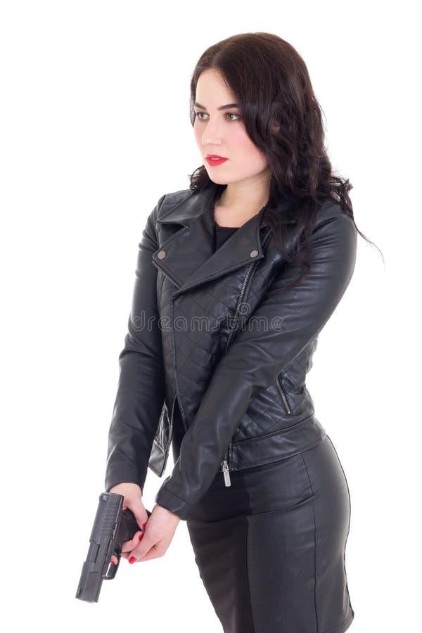 Portrait de femme sexy dans le noir avec l'arme à feu d'isolement sur le blanc photographie stock