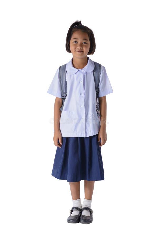 Portrait de fille asiatique dans l'uniforme scolaire d'isolement sur le fond blanc image libre de droits