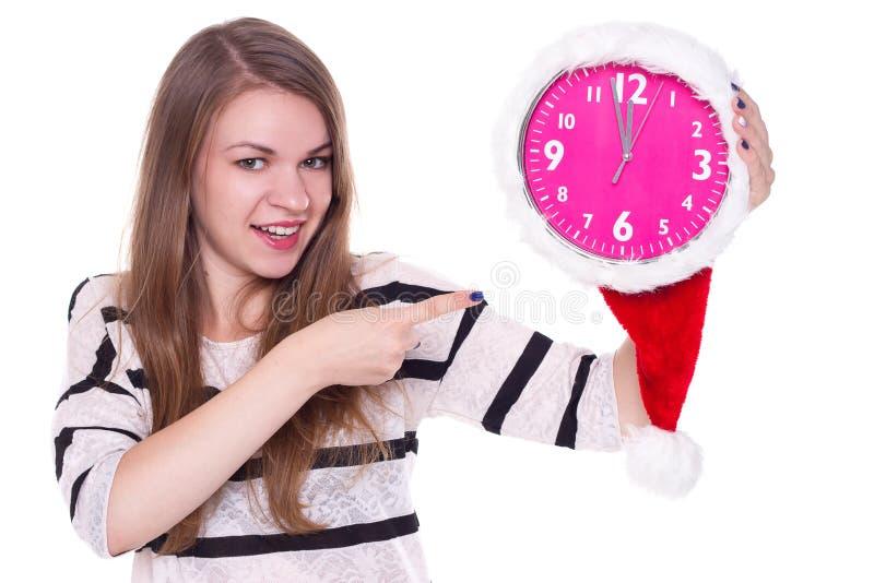 Portrait de fille de Santa avec l'horloge Fond blanc photographie stock