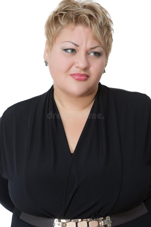 Portrait de grosse femme triste, d'isolement sur le blanc image stock