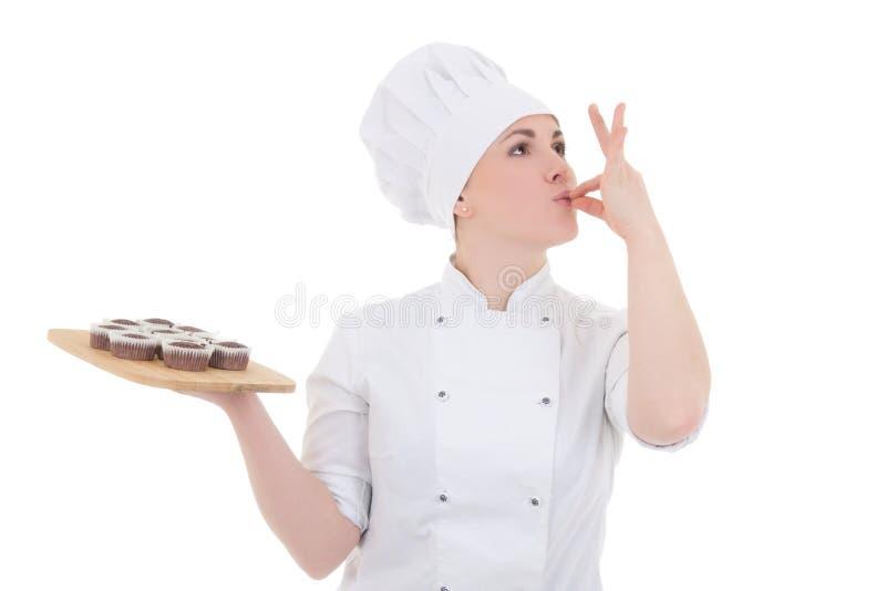 Portrait de jeune femme attirante de cuisinier dans l'uniforme avec le chocolat photographie stock
