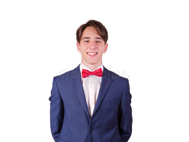 Portrait de jeune homme élégant dans le costume et le noeud papillon, d'isolement sur le fond blanc images stock