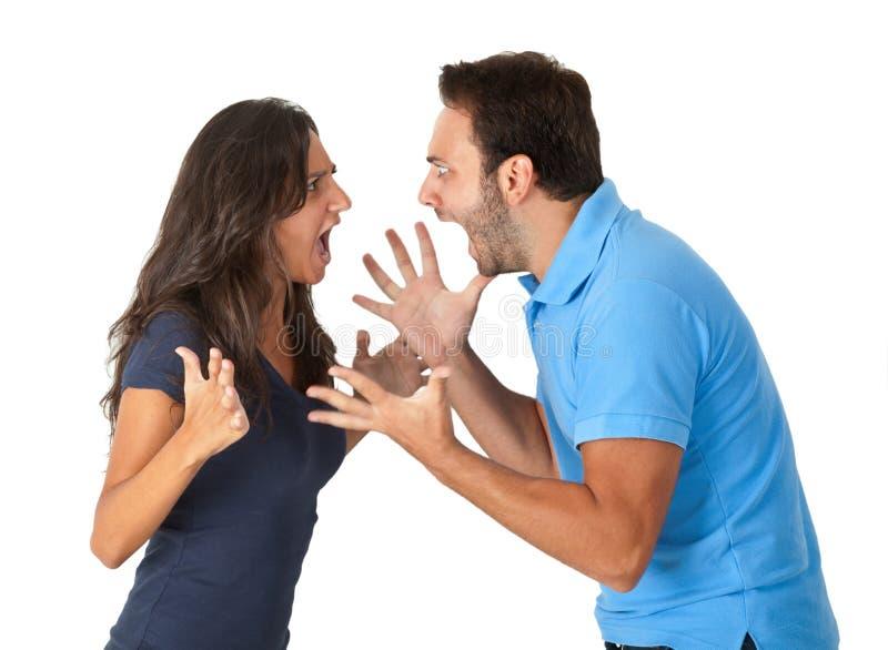Portrait de jeunes couples fâchés photos stock