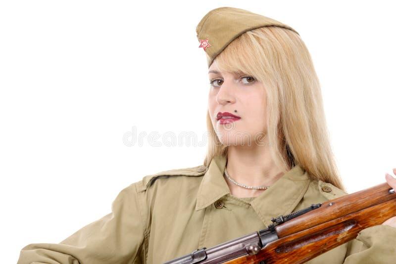Portrait de jolie jeune femme dans l'uniforme militaire russe, sur W image stock