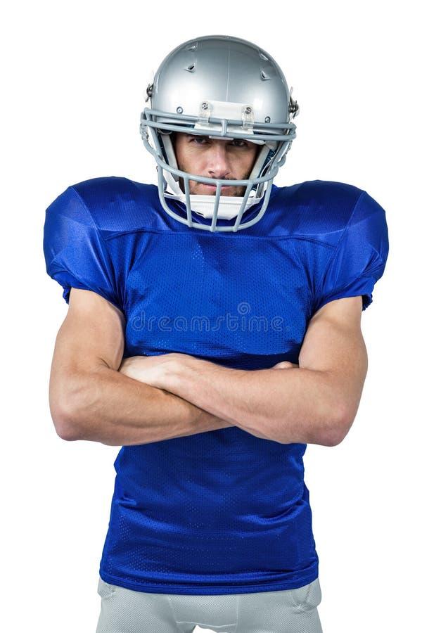 Portrait de joueur de football américain avec des bras croisés image stock