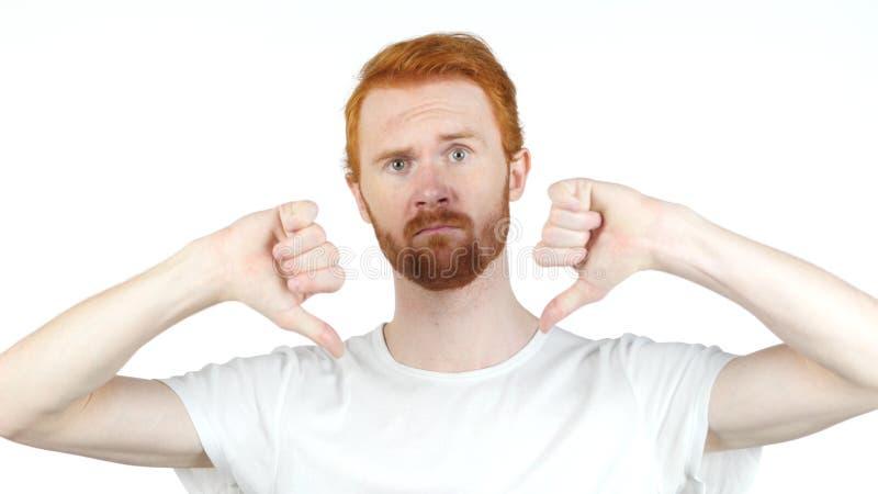 Portrait de l'homme bel fâché, malheureux, jeune montrant des pouces vers le bas photographie stock