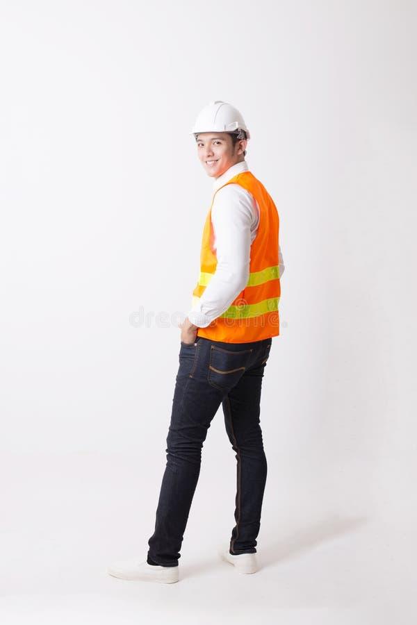 Portrait de l'ingénieur ou de l'architecte asiatique Designer à l'arrière-plan d'isolement avec le signe de geste image libre de droits