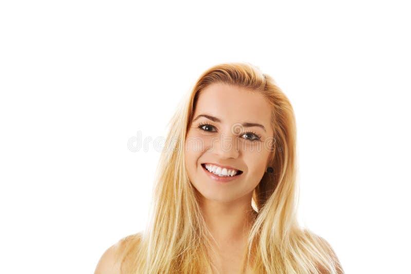 Portrait de la fille attirante d'adolescent souriant, au-dessus du blanc photos stock