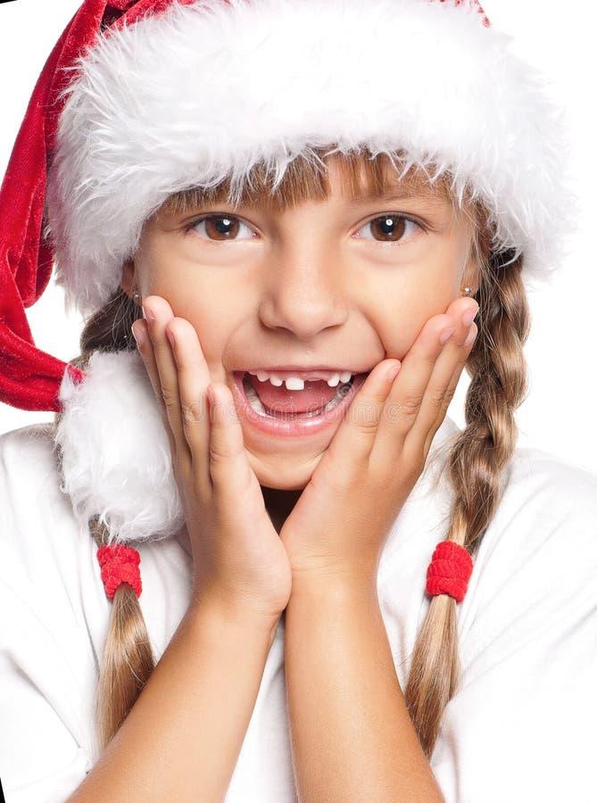 Portrait de petite fille heureuse dans le chapeau de Santa photographie stock
