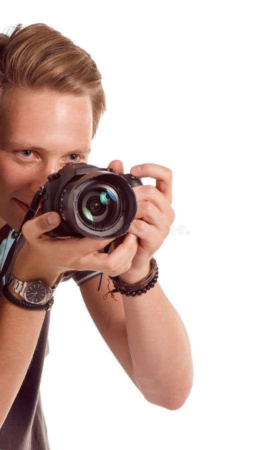 Portrait de plan rapproché d'un jeune homme prenant une photo de coin photo stock