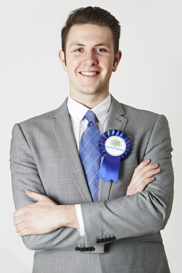 Portrait de politicien conservateur Wearing Blue Rosette photo libre de droits