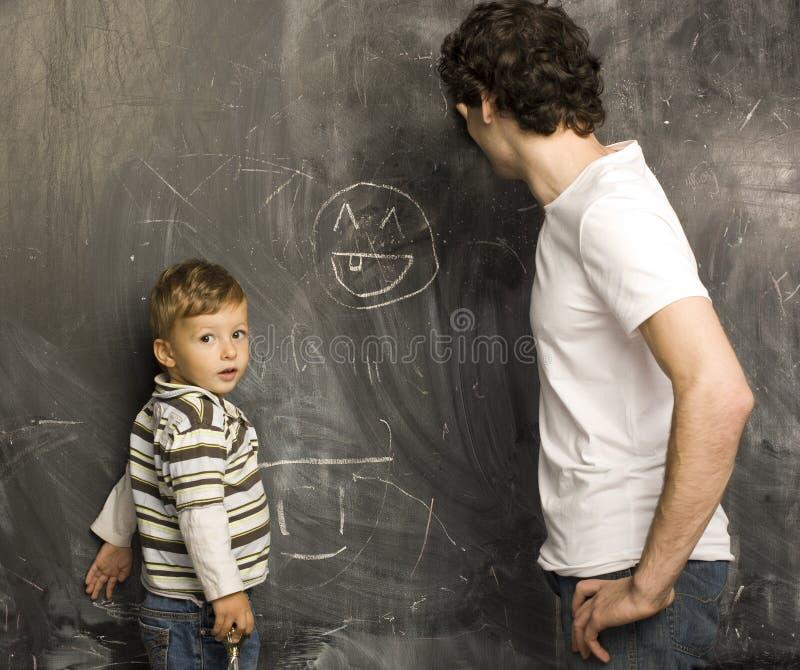 Portrait de professeur et de petit étudiant photo libre de droits