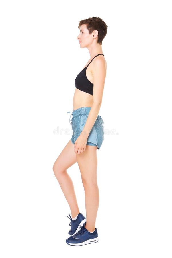 Portrait de profil de jeune femme sportive en bonne santé sur le fond blanc d'isolement photo stock