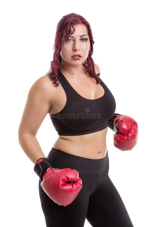 Portrait de studio des gants de boxe de port de femme photo stock