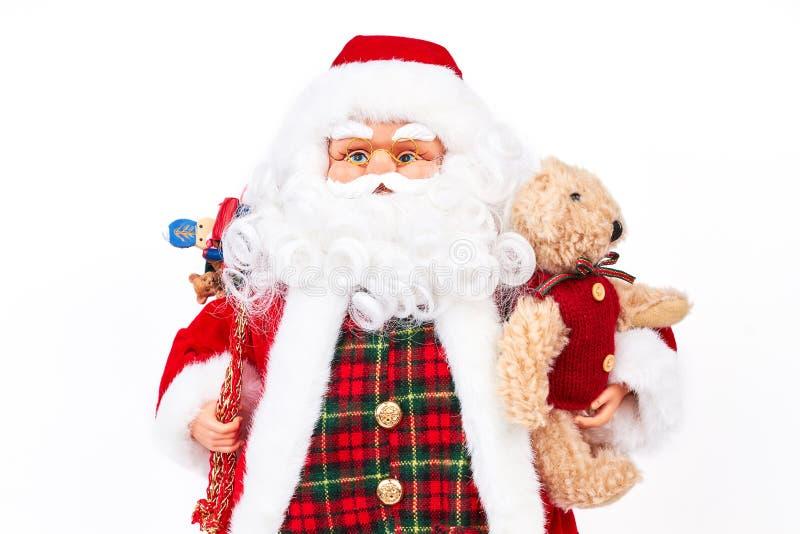 Portrait de studio de poupée de Santa Claus avec des présents image stock