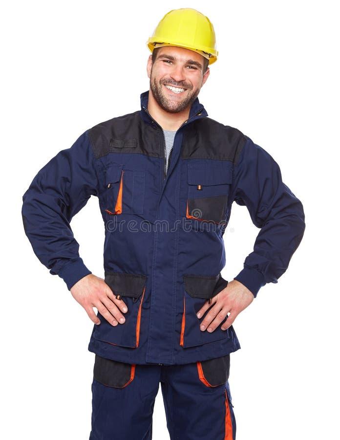 Portrait de travailleur de sourire dans l'uniforme bleu photos stock