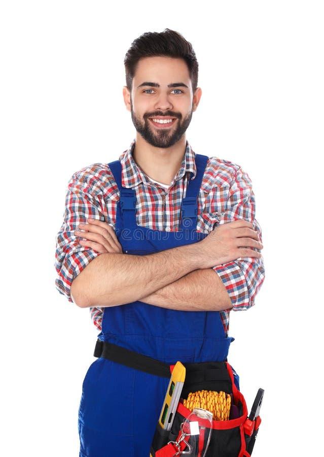 Portrait de travailleur de la construction avec la ceinture d'outil photographie stock