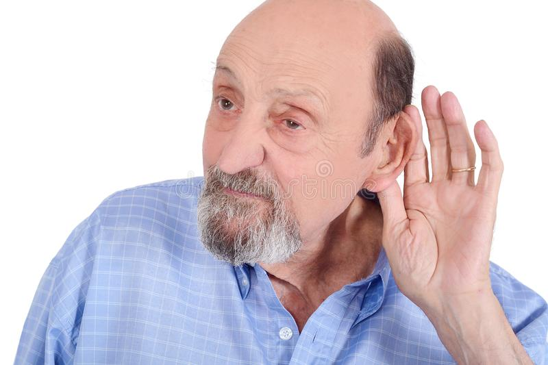 Portrait of deaf old man trying to listen. Isolated in a white background royalty free stock photos