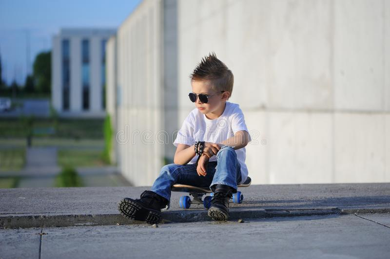 A Portrait Of Defiant Boy With Skateboard Outdoors. Stock ...