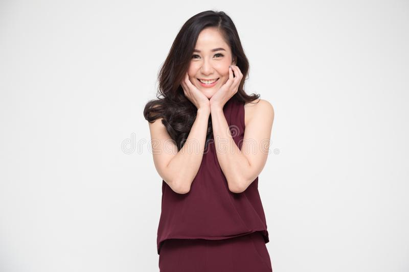 Portrait of delighted Asian woman smiling and dreamy expression, royalty free stock photo