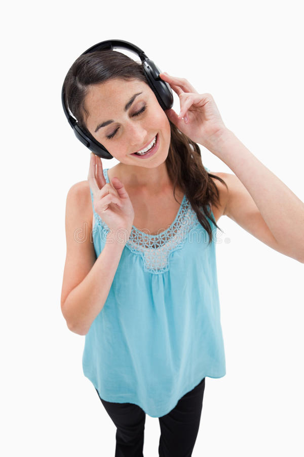 Download Portrait Of A Delighted Woman Listening To Music Stock Photo - Image: 22662694