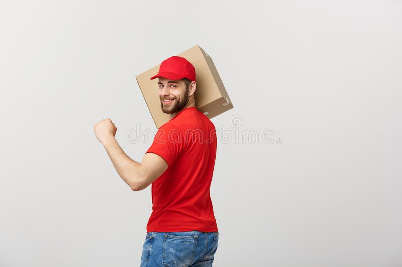 Portrait delivery man in cap with red t-shirt working as courier or dealer holding two empty cardboard boxes. Receiving stock image
