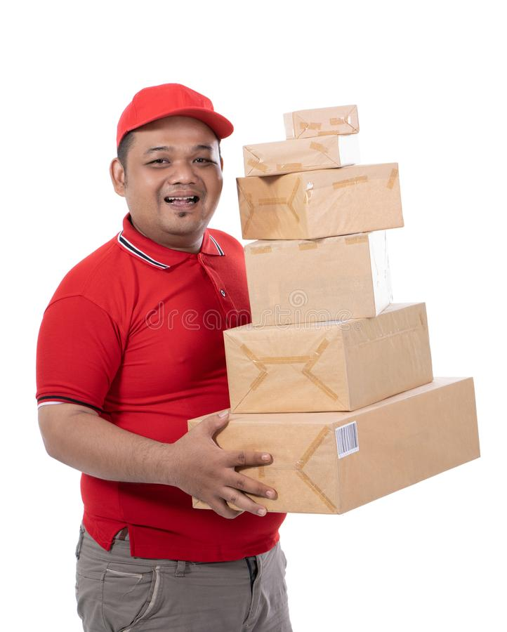 Portrait of delivery man smile holding boxes stock photos