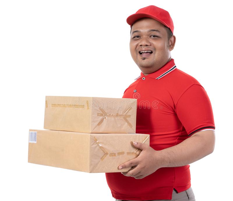 Portrait of delivery man smile holding boxes royalty free stock images