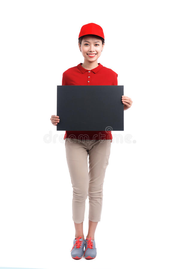 Portrait of delivery woman holding board isolated on white background. stock image