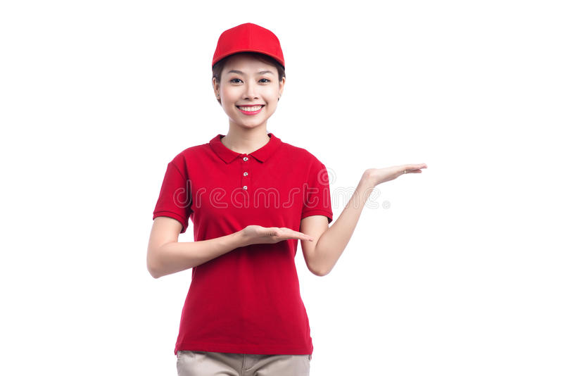 Portrait of delivery woman show something isolated on white back. Ground stock photos