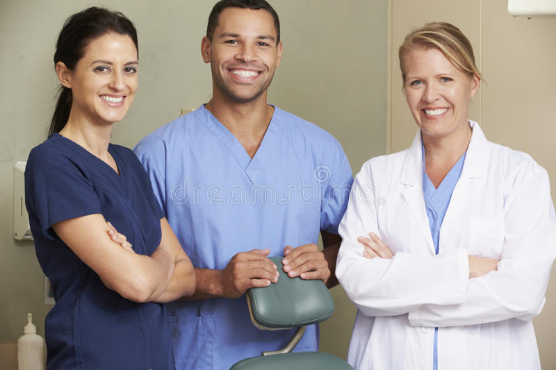 Portrait Of Dentist And Dental Nurses In Surgery royalty free stock photography