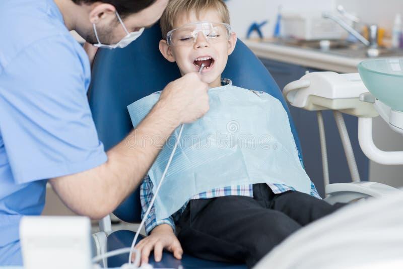 Brave Little Boy Visiting Dentist royalty free stock photography