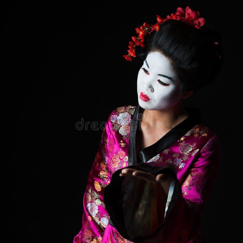 Portrait der Geisha etwas darstellend stockfotografie