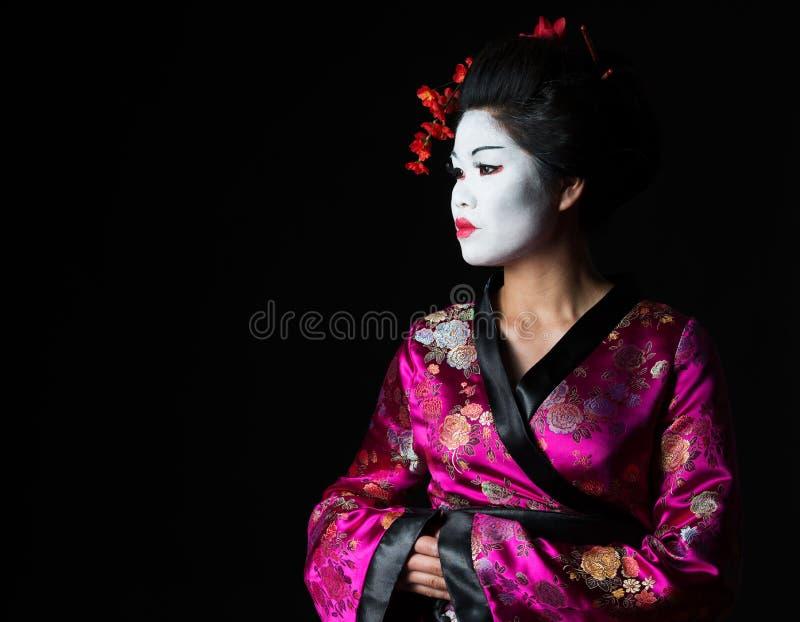 Portrait der Geisha schauend auf Exemplarplatz lizenzfreies stockfoto