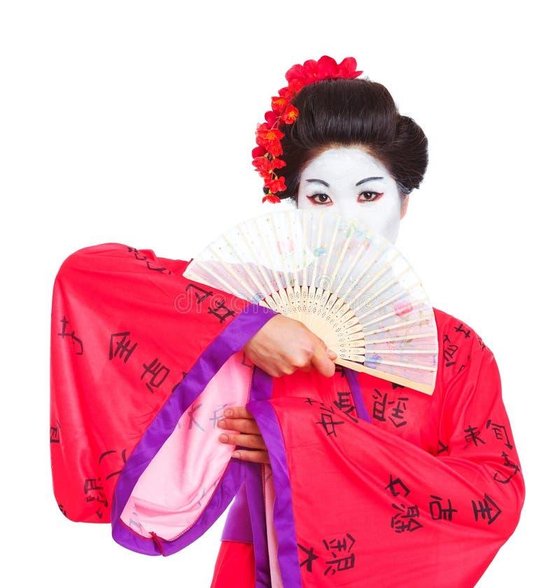 Portrait der Geisha versteckend hinter Gebläse lizenzfreie stockfotografie