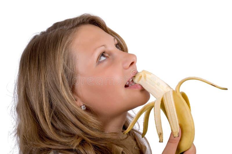Portrait der jungen Frau mit einer Banane lizenzfreie stockfotografie