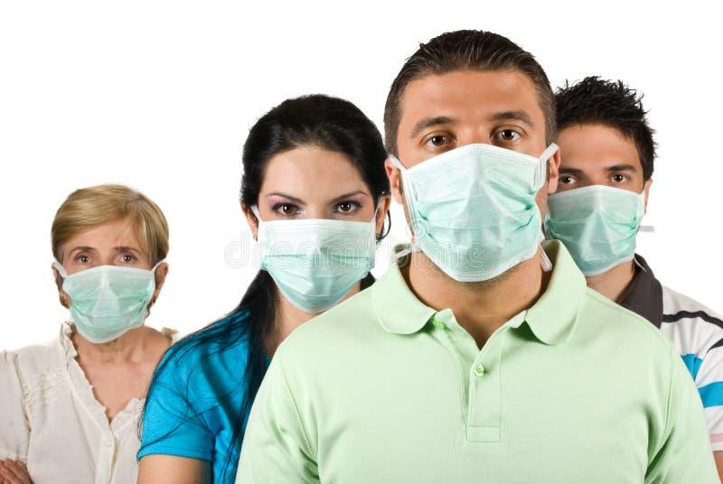 Portrait der Leute schützen sich vor Grippe lizenzfreie stockfotos