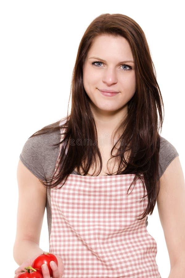 Portrait der Tomaten einer der jungen Frau Holding stockbilder