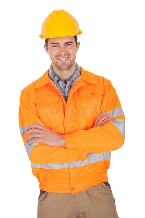 Portrait der tragenden Sicherheitsjacke der Arbeitskraft lizenzfreie stockfotos