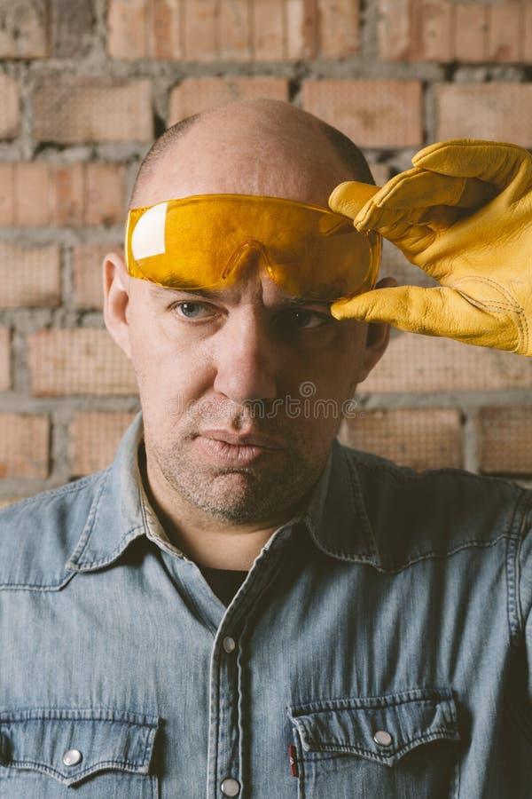 Portrait des Bauarbeiters stockbilder